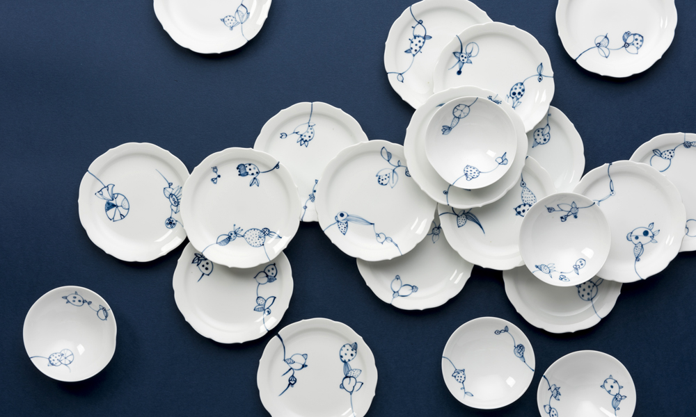 blue and white dishes blue background